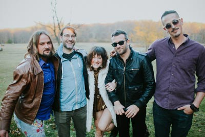 Maddy Walsh and The Blind Spots band standing together