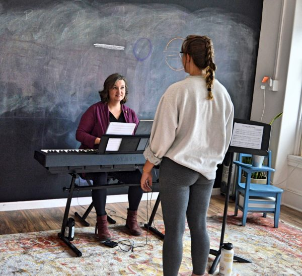 Sharon teaching vocal lessons to a student